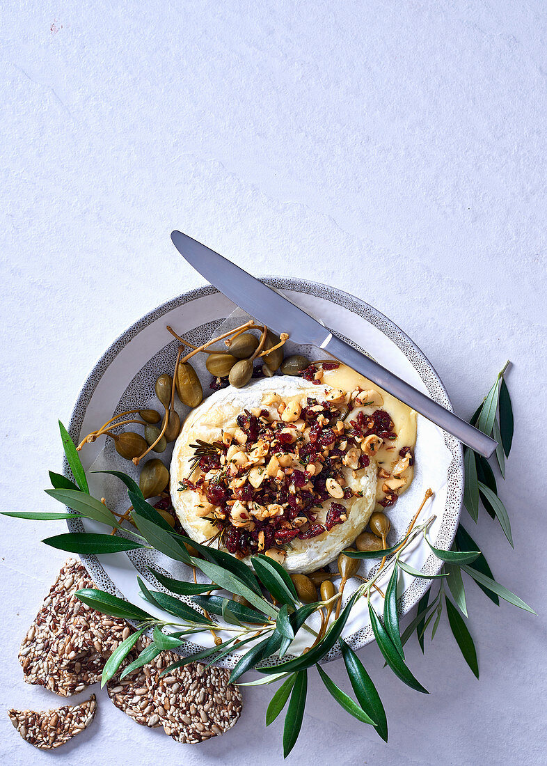 Baked camembert with rosemary, macadamia and cranberry crumble