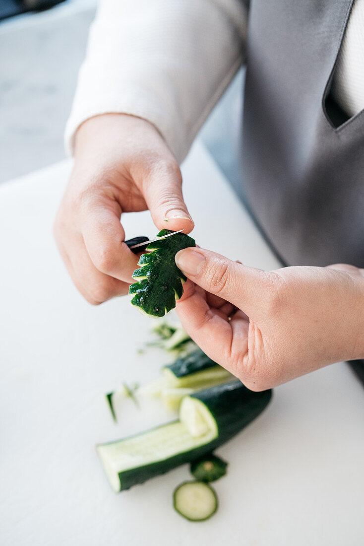 A carved cucumber leaf