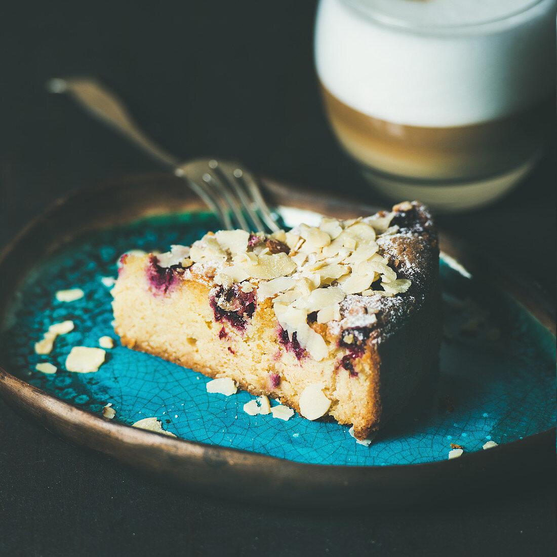 Dessert and coffee. Piece of lemon, ricotta, almond and raspberry gluten-free cake