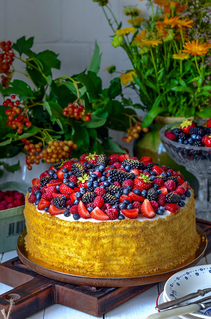 Summer cake with berries from own garden
