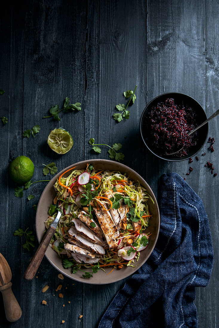 Oriental vegetable salad with grilled chicken and red rice