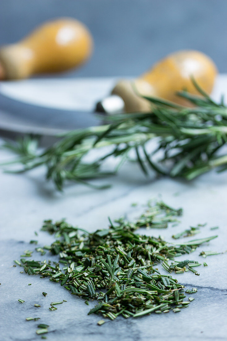 Chopped rosemary with a mezaluna
