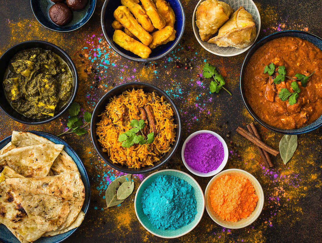 Classic Indian dishes for Holi served with Holi powder