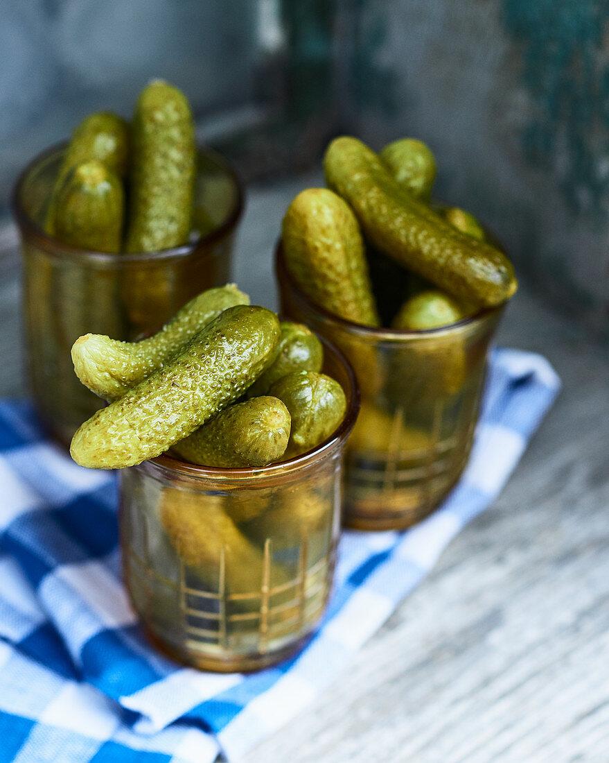 Pickled gherkins in glasses