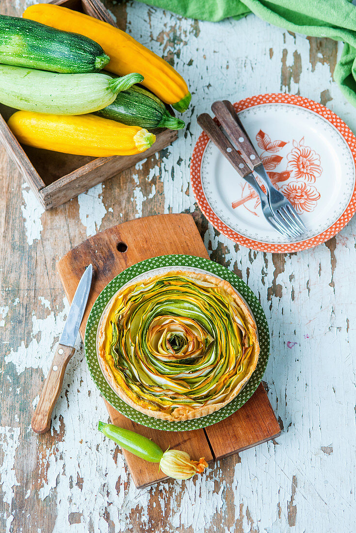 A spiral tart with green and yellow zucchinis