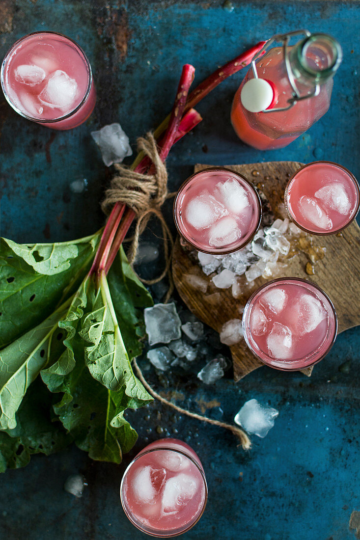 Rhubarb juice with ice cubes in glasses