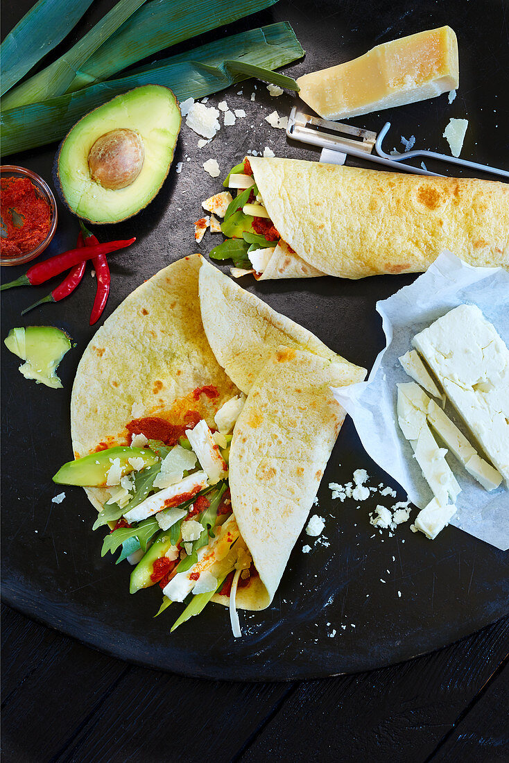 Wraps with avocado, rocket, cheese and chilli