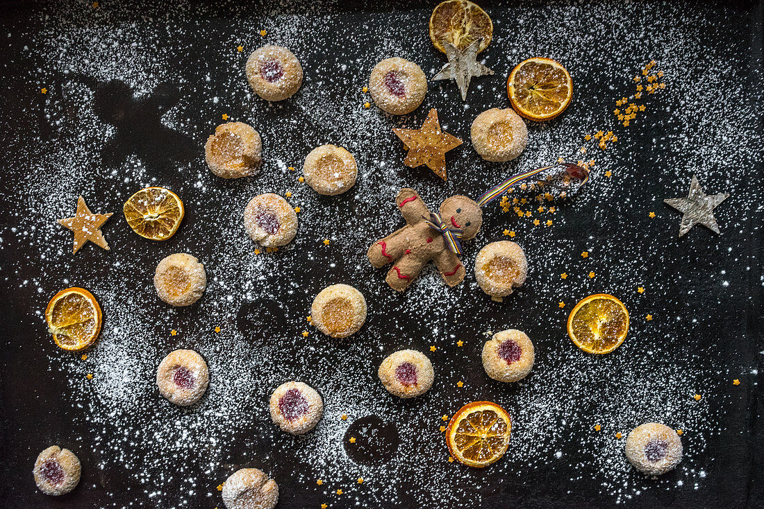 Shortbread jam biscuits with orange slices, stars and a Christmas figure