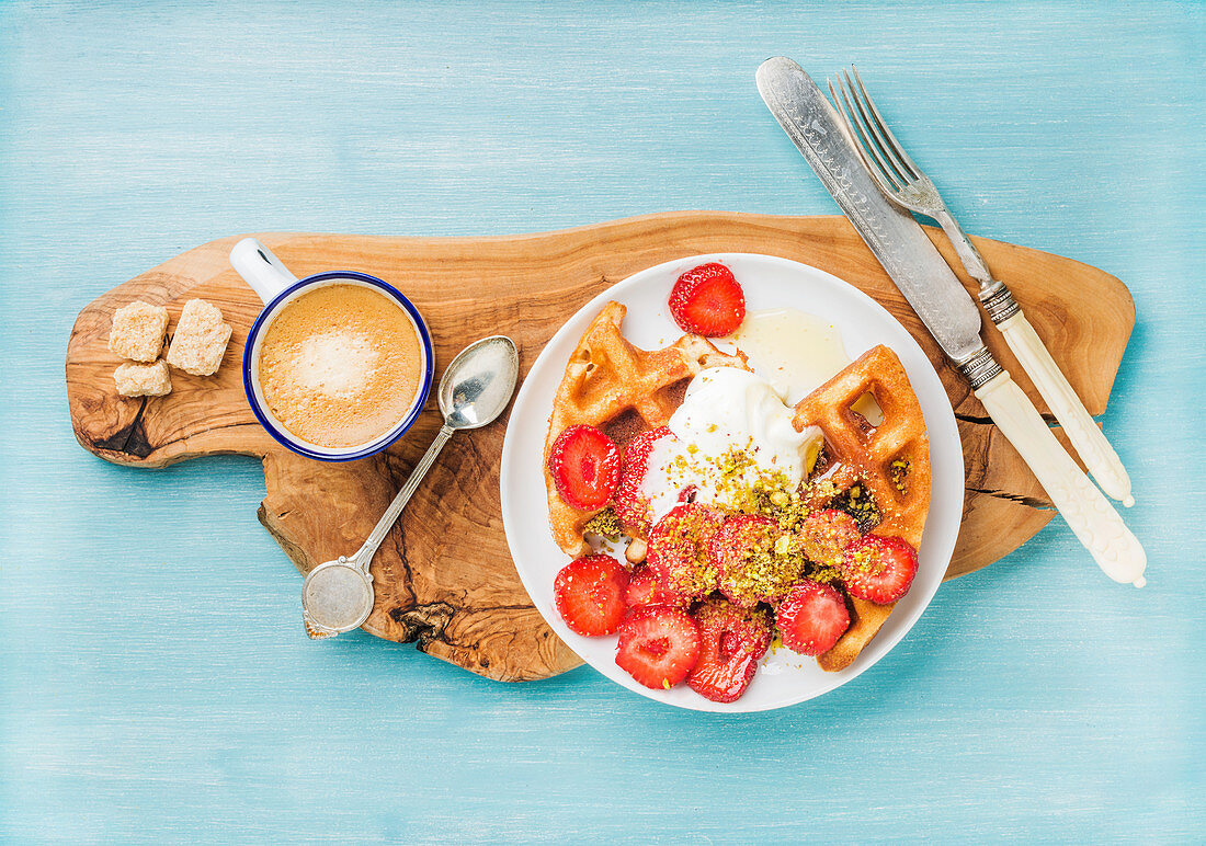 Breakfast set - Warm homemade belgium waffles with whipped cream, strawberry, maple syrup and crushed pistachios