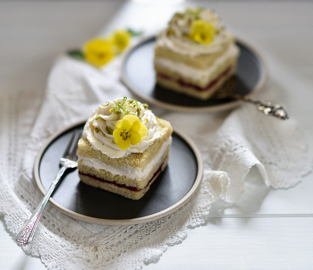 Vegan lime and sour cream cakes with a light raspberry sponge layer and whipped sour cream