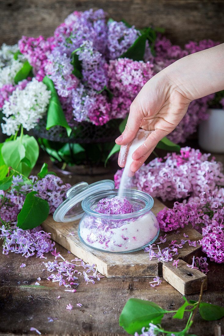 Sugar and lilac flowers being mixed