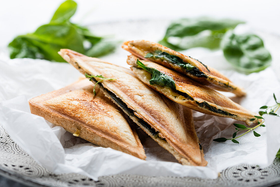 Toasted vegan sandwiches with tofu and spinach