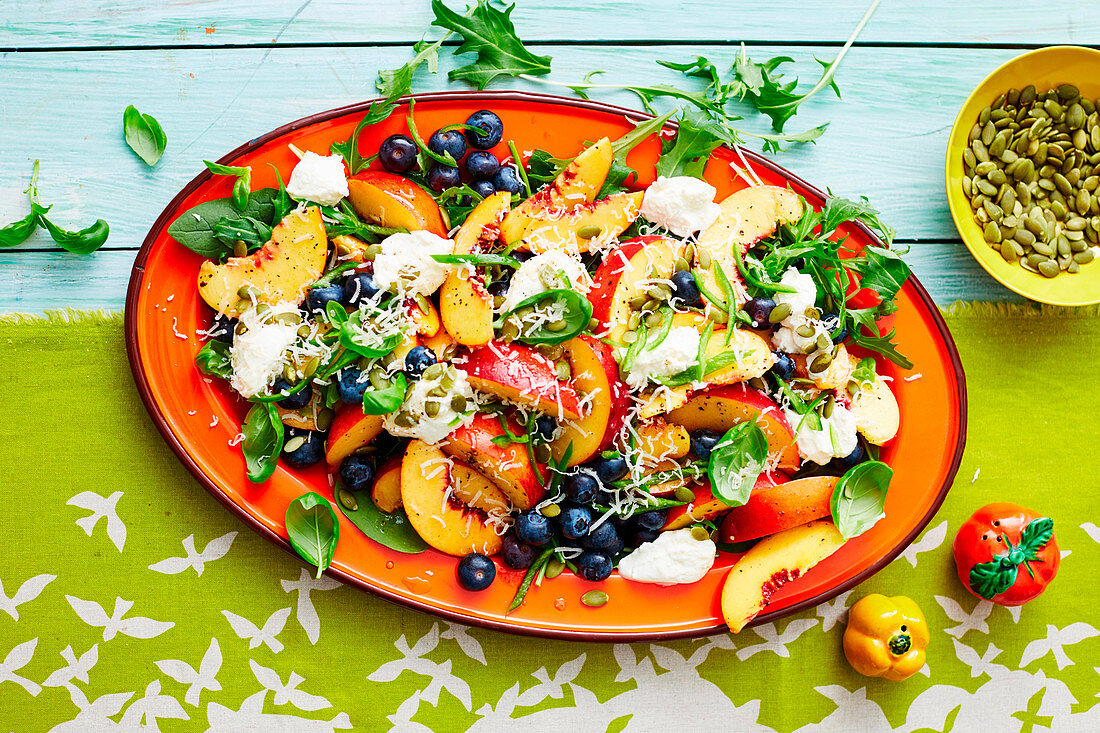 Summer salad of peaches and blueberries