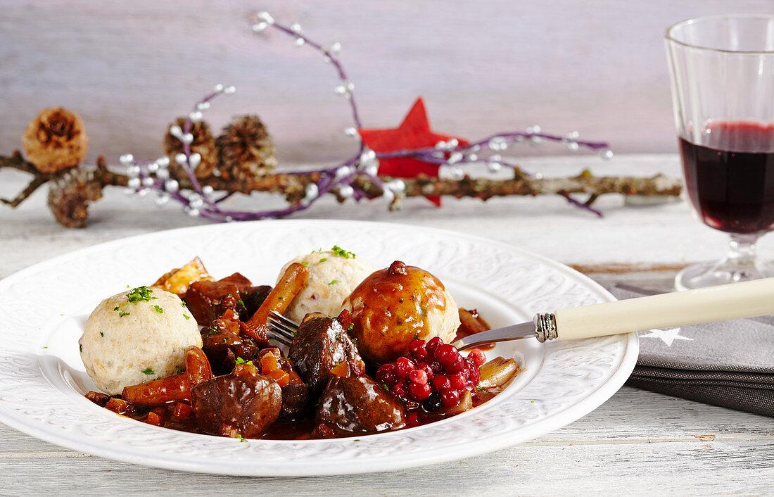 Venison goulash with bacon, chanterelle mushrooms, mini bacon dumplings and lingon berries