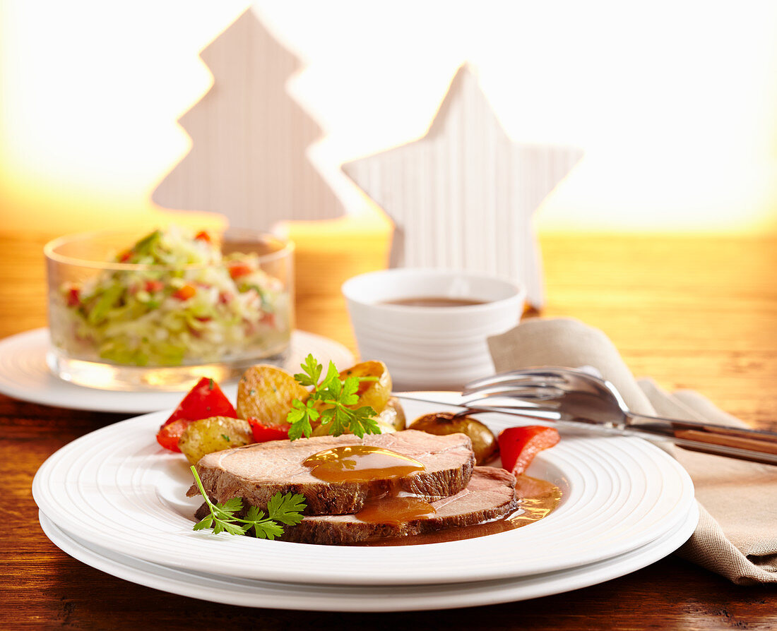 Roast wild boar with coleslaw and fried potatoes