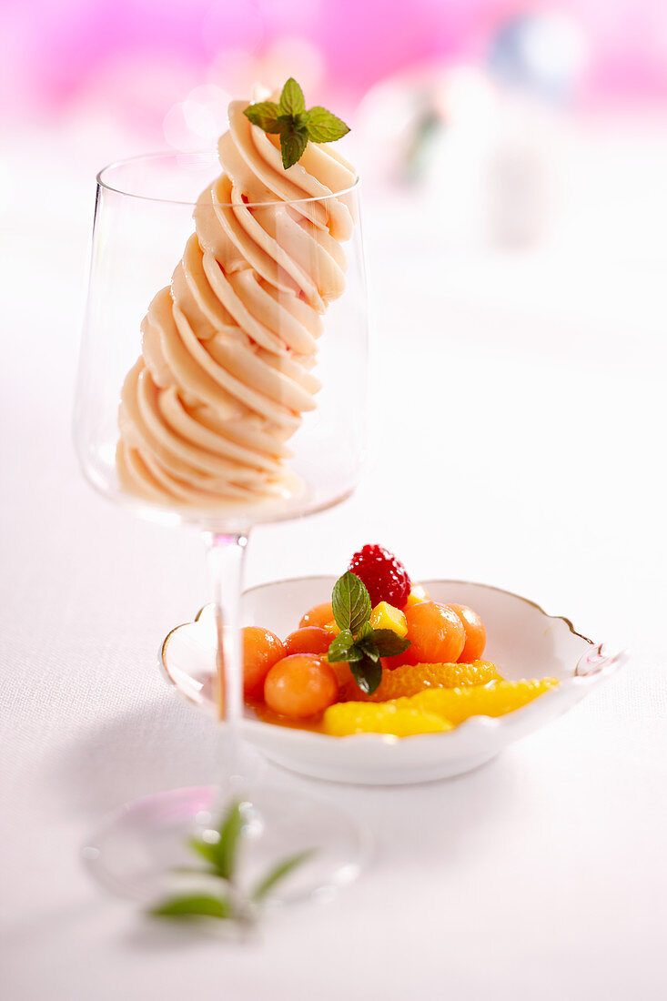 Papaya and orange sorbet in a glass with an exotic fruit salad