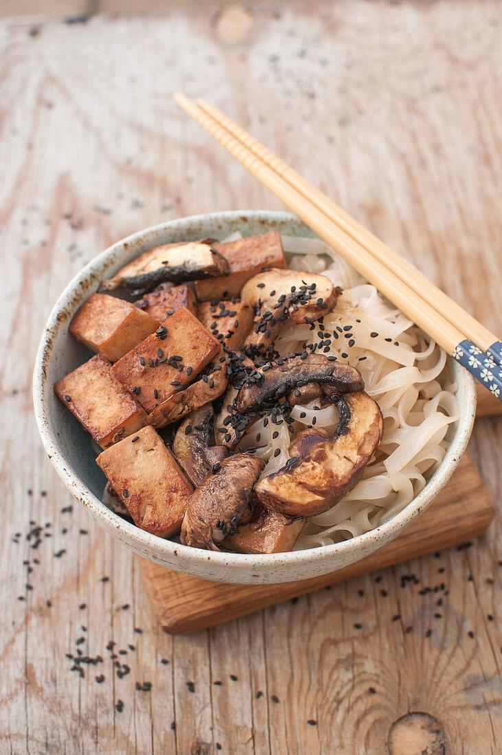Vegan stir fry - rice noodles, tofu, mushrooms, sesame