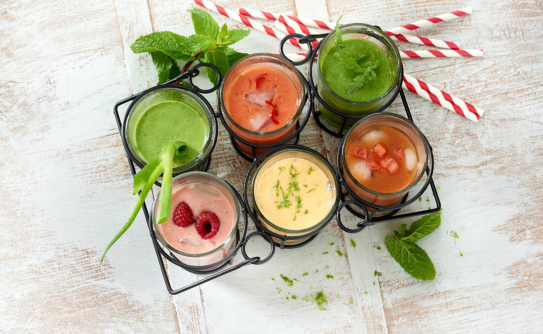 Colourful smoothies with fruit, vegetables and herbs