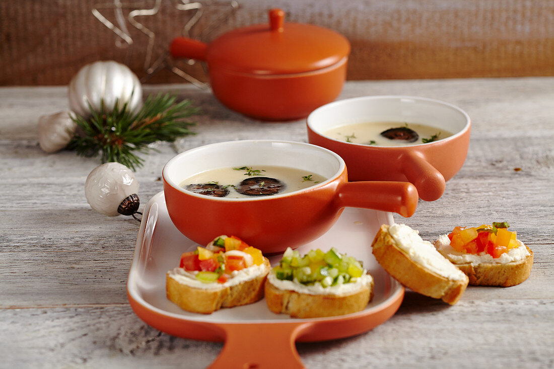 Cream of Parmesan soup with candied walnut, and baguette topped with tomato and cucumber tartare