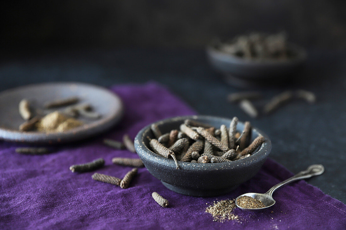 Long pepper in grey bowls