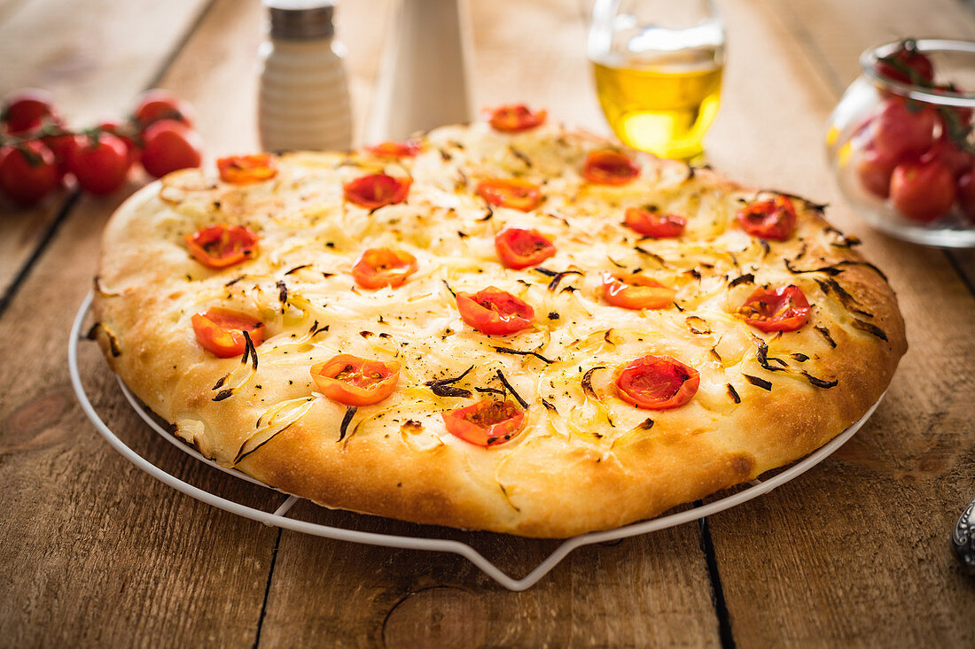 Simple focaccia bread with cherry tomatoes and onions