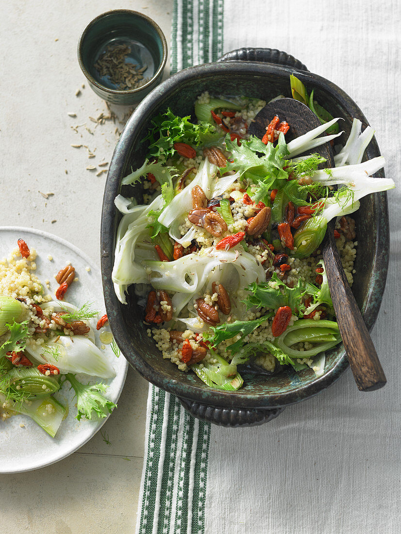 Millet salad with wild Brazil nuts, goji berries, pomegranate seed, frisee lettuce and fennel