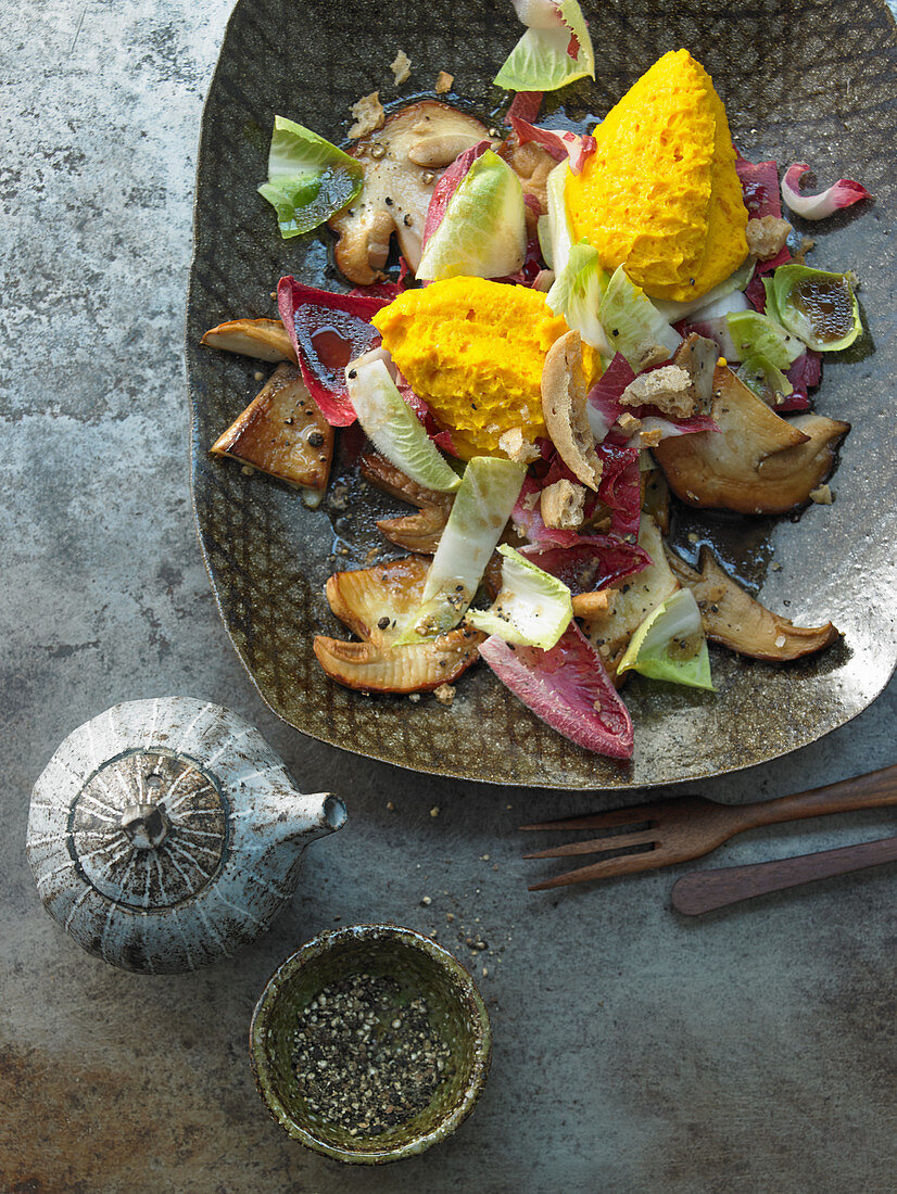 Pumpkin mousse on a porcini mushroom carpaccio with an autumnal salad and crispy unleavened bread from South Tyrol