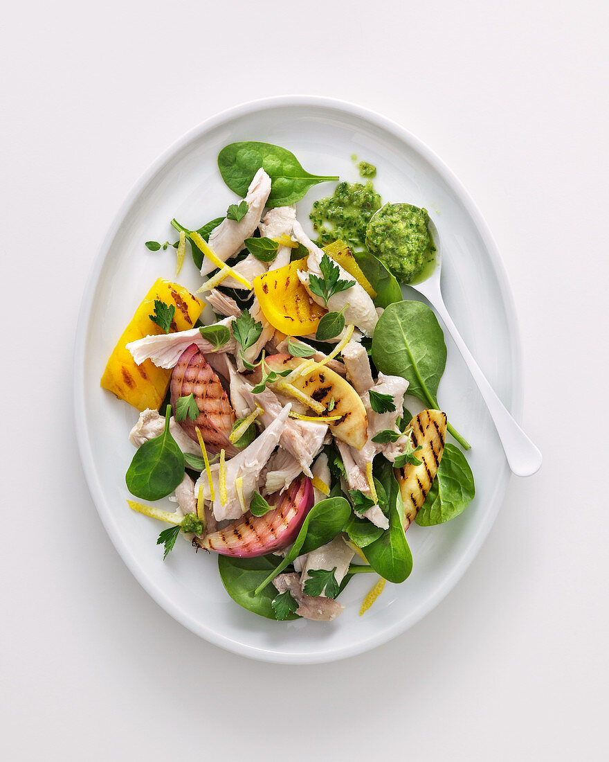 Chicken salad with peaches, peppers, onions and cress sauce