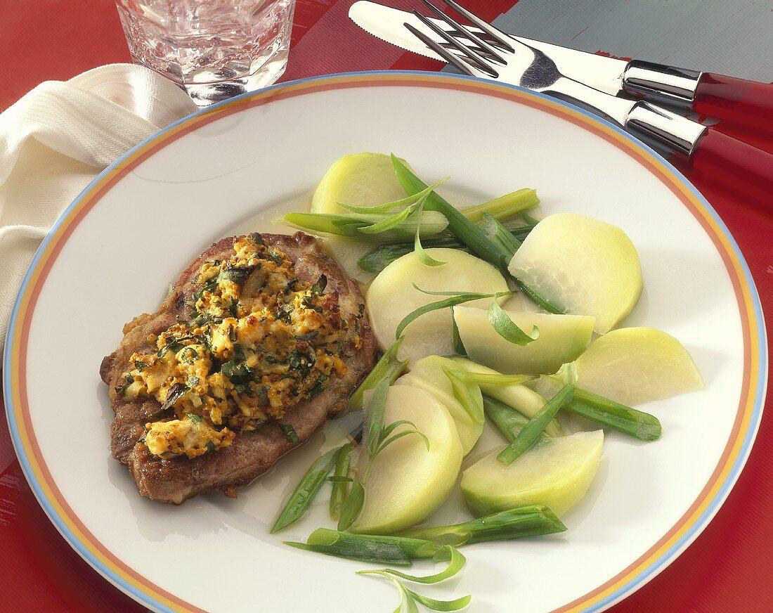 Pork steak with bread and potato crust and kohlrabi
