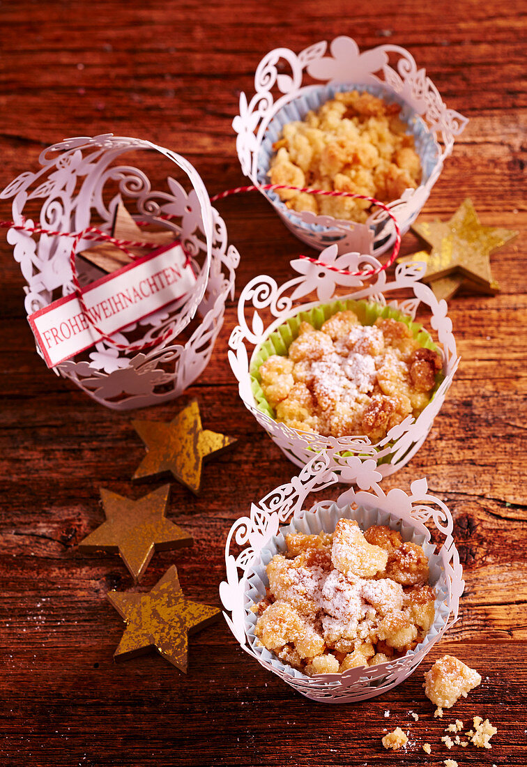Small apple crumble muffins in paper cups for Christmas