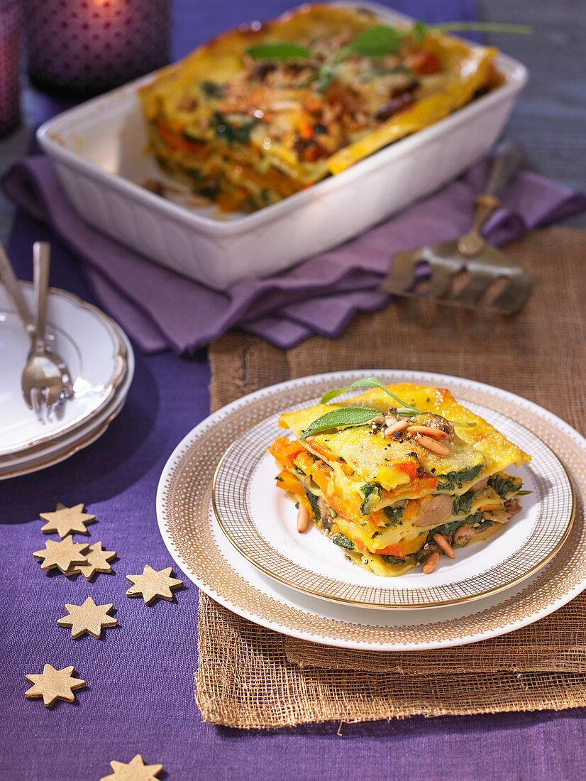 Spinach and pumpkin lasagna with orange and mustard sauce for Christmas