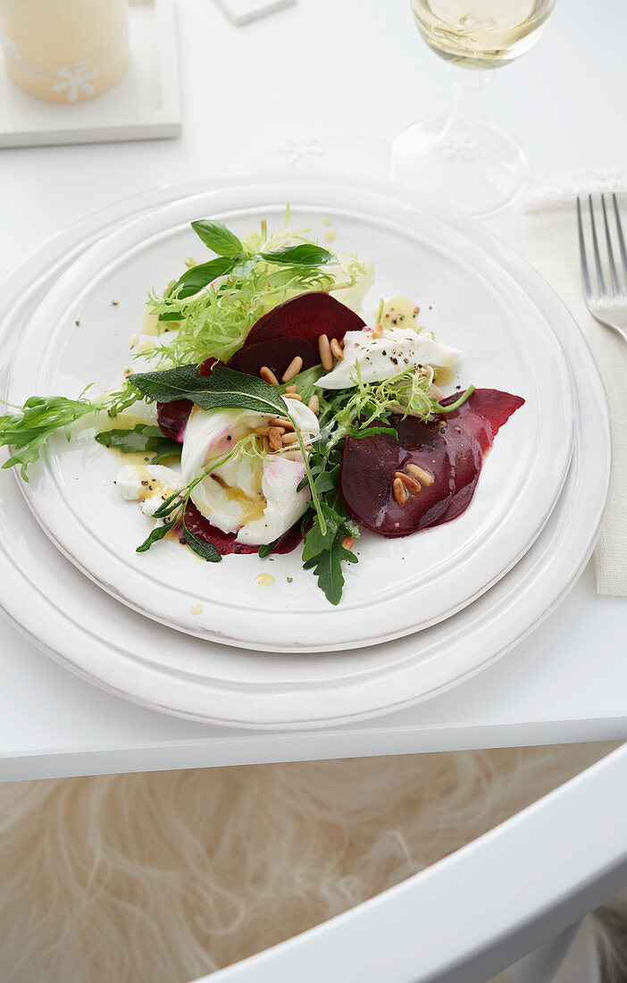 Beetroot salad with mozzarella and pine nuts for Christmas