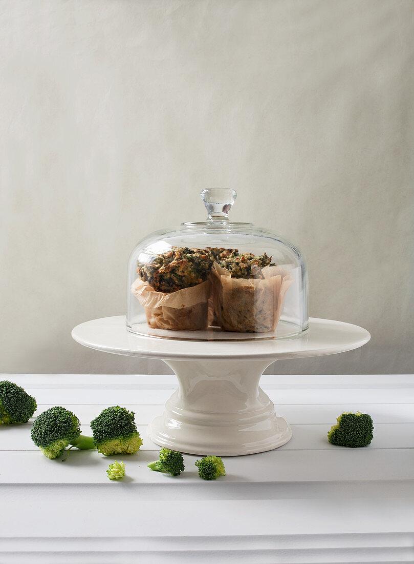 Brocolli Muffins in Parchment Paper Under a Glass Cloche