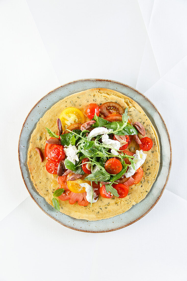 Socca with tomatoes