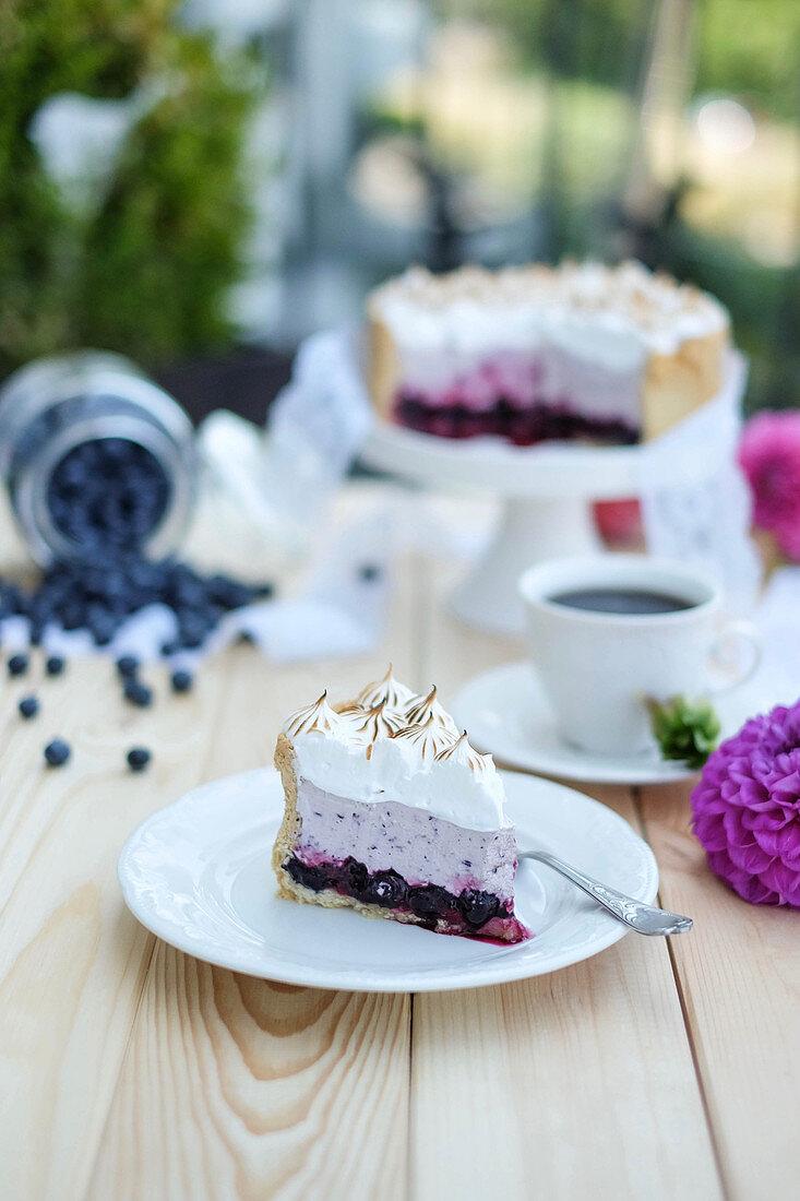 Blueberry meringue cake, sliced