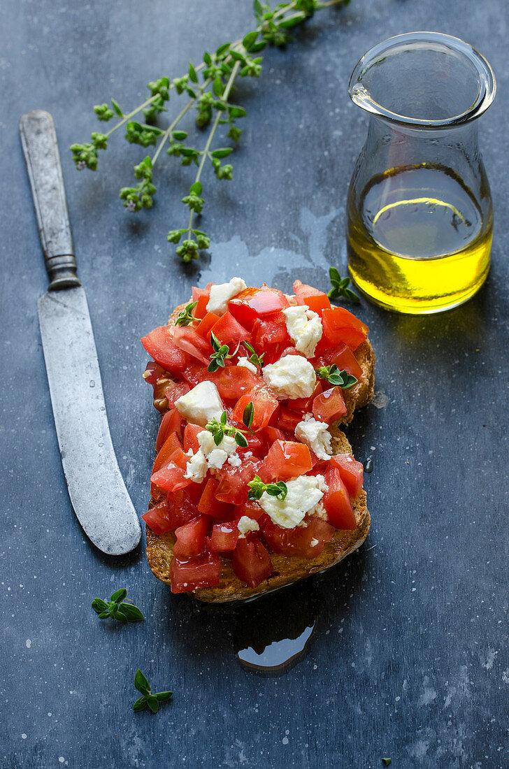 Bruschetta with fresh tomatoes, feta and oregano