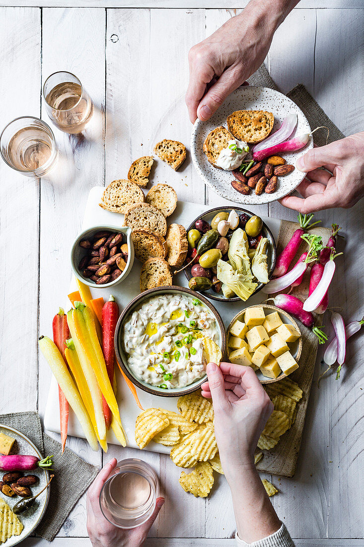 Onion Dip Platter with two people eating