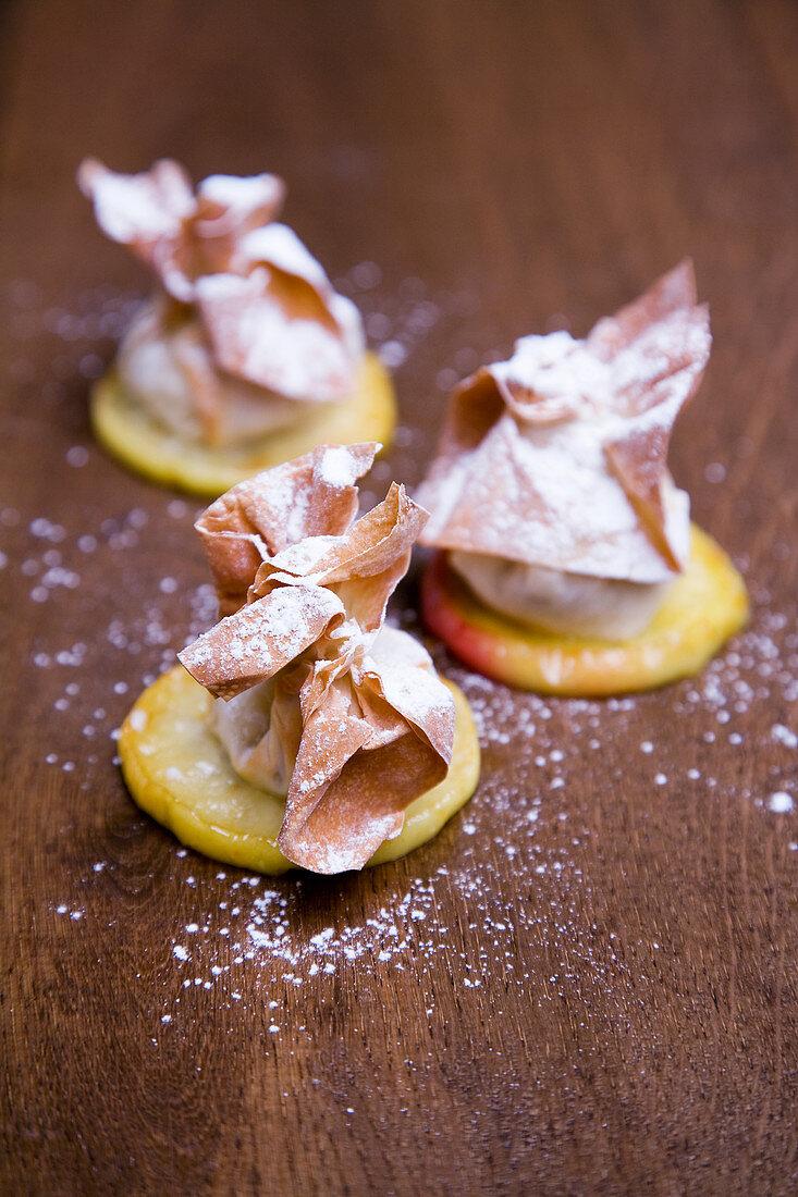 Pear strudel on glazed apple slices