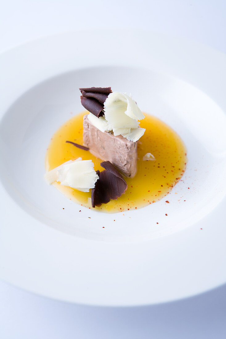 chocolate parfait on orange sauce with piment d'espelette