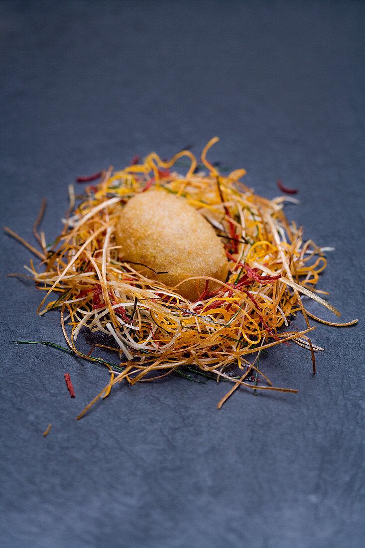 A foie gras egg with crispy organic vegetables, peach coulis and porcini mushrooms