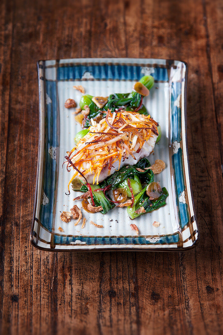 Red snapper with a sweet potato and coconut crust on bok choy