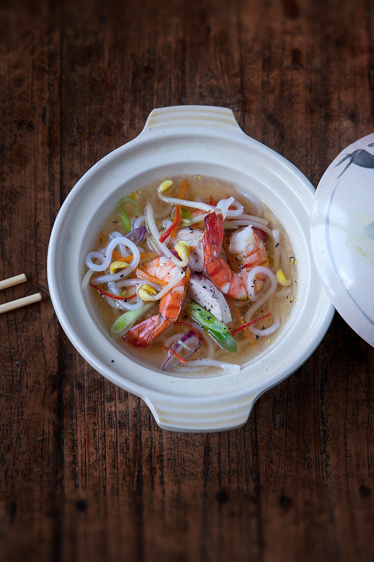 Spicy noodle soup with chicken and prawns