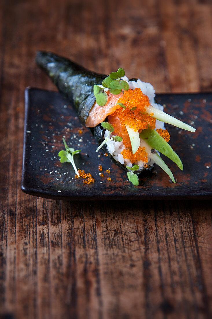 Temaki sushi with marinated salmon, cucumber and avocado