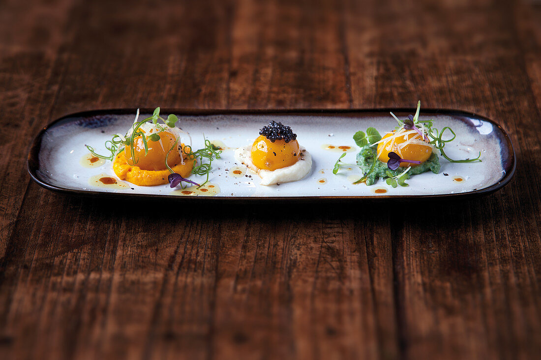 Cured egg yolks with a trio of vegetable purée