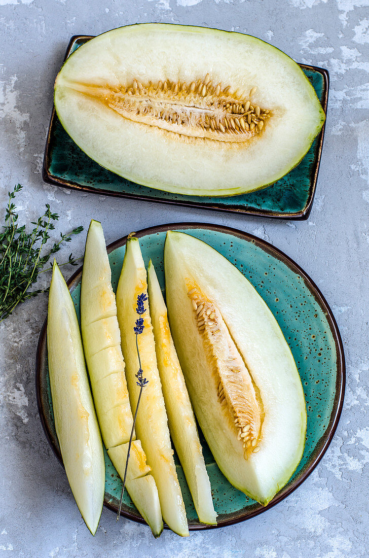 Juicy melon in a cut on the kraft plates