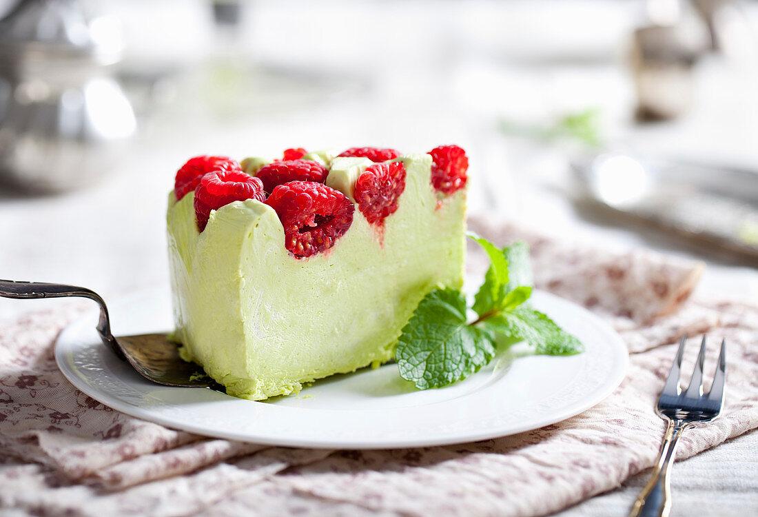 Pistachio mousse cake, cheesecake with fresh raspberry