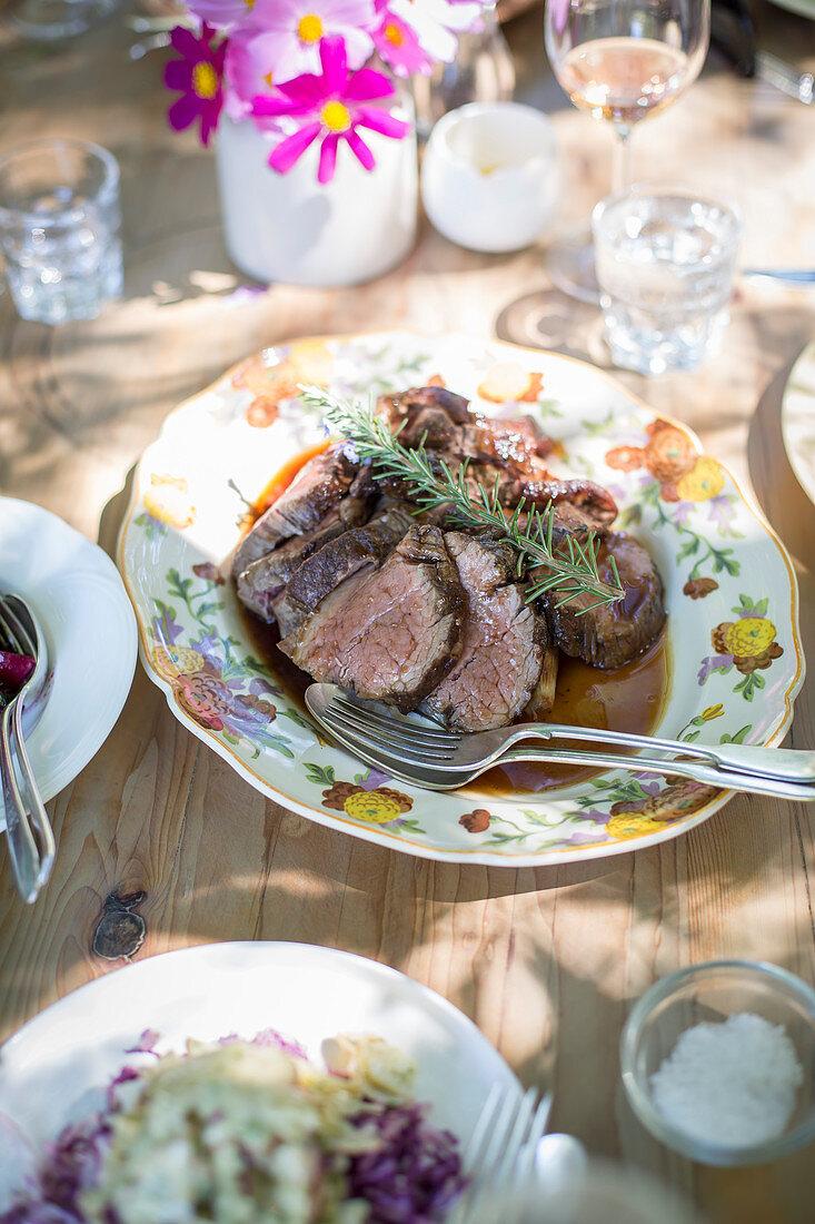 Roast beef on platter on table