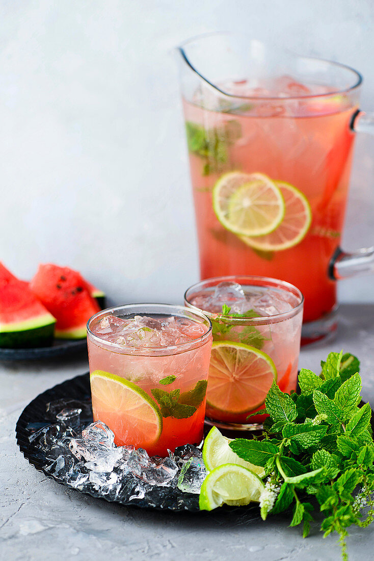 Watermelon lemonade with mint in glasses and a carafe