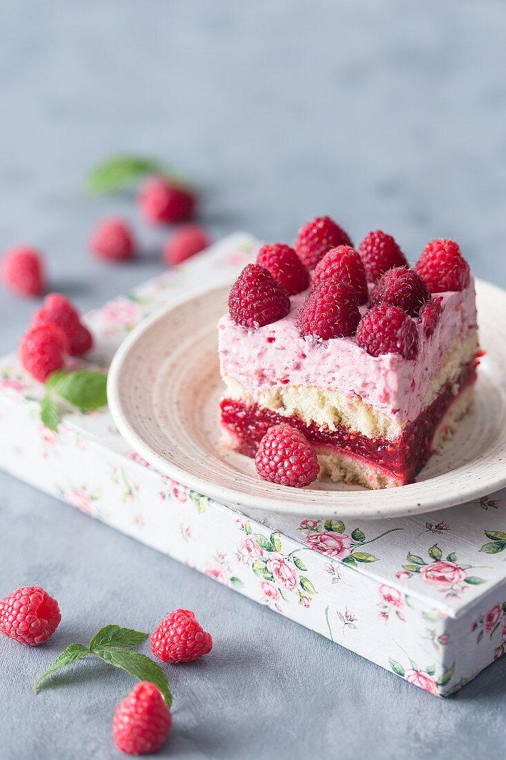 Slice of a raspberry no bake cream cake