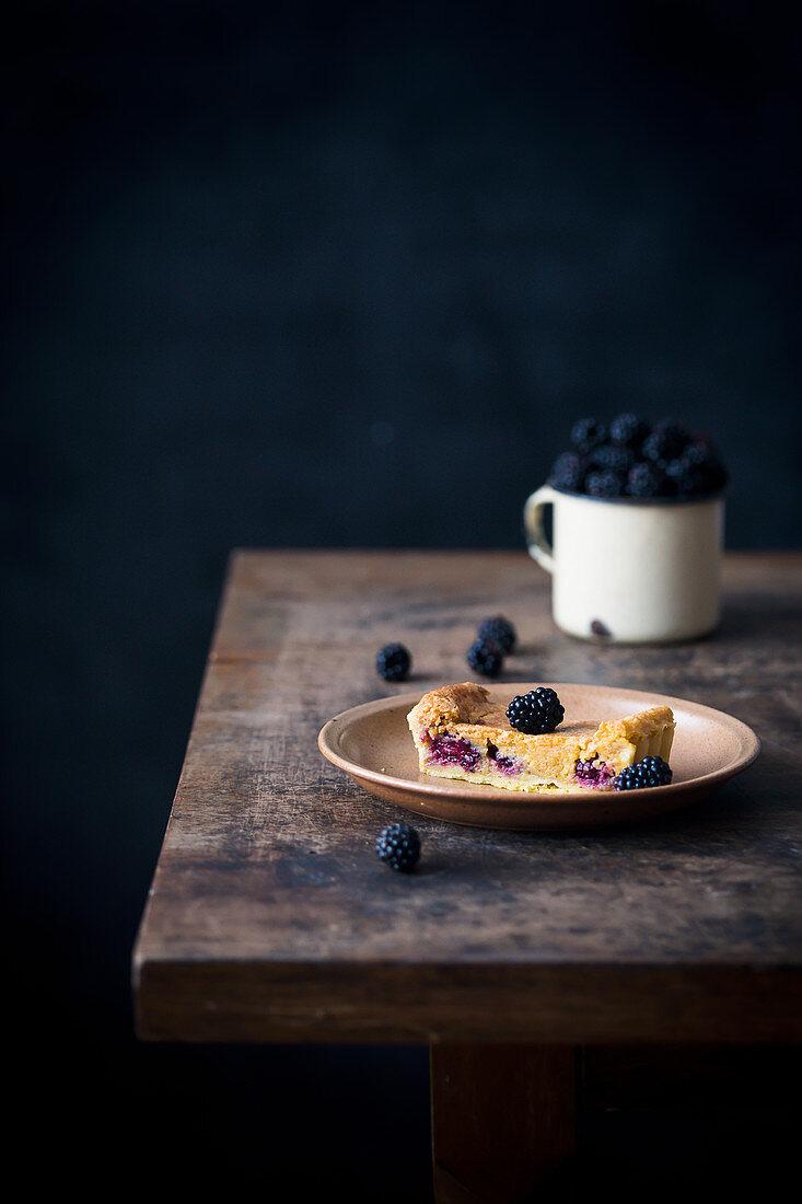 Slice of a blackberry almond tart